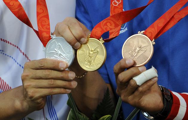 图文-[奥运]男子个人射箭决赛 金银铜不同的成色