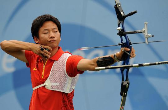 图文-中国男团获得铜牌 中国选手李文全在决赛中