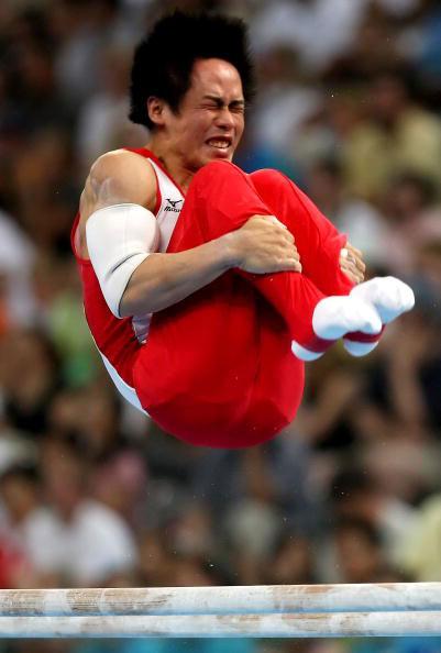 图文-体操男子全能杨威夺冠 富田洋之空中反转