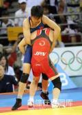 图文-女子自由式摔跤55KG许莉摘银 怒摔就是胜利