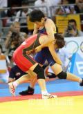 图文-女子自由式摔跤55KG许莉摘银 借巧劲抱摔