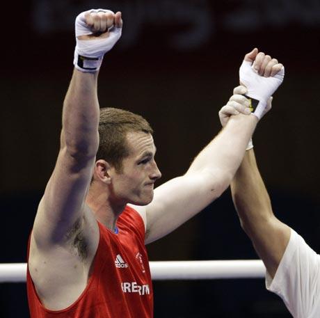 图文-18日奥运拳击赛场赛况 胜利者的姿态