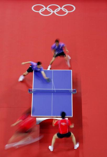 图文-14日奥运会乒乓球赛况 选手移动快如闪电
