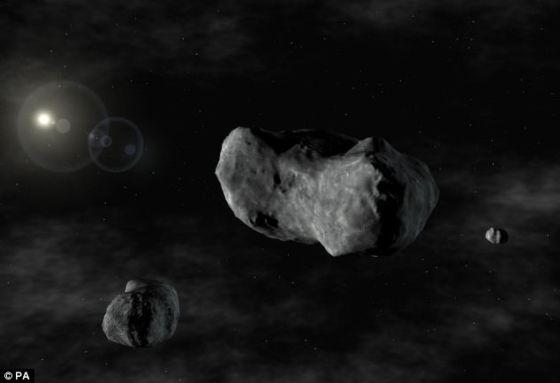 """捕捉小行星还为开采矿物资源创造了可能性。这张照片显示的是小行星87 Sylvia,以及它的两颗""""小卫星"""" 罗穆卢斯和瑞摩斯,后者是在1866年发现的"""