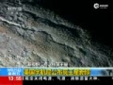 美宇航局公布冥王星新照 地表山脉绵延色彩丰富