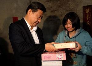 视察顺德送贫困家庭孩子英文字典