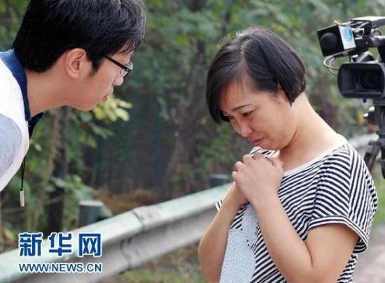 2012年8月10日,被释放的唐慧接受新华社记者采访。新华社记者 龙弘涛 摄
