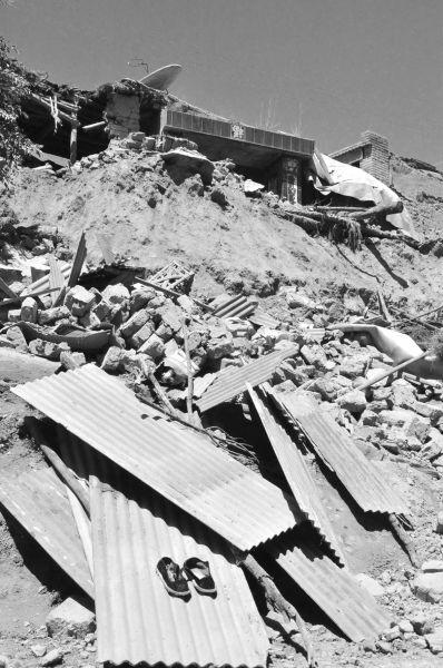 7月22日,甘肃省岷县马家沟村一处受损的房屋。新华社发