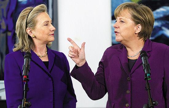 双雌相争,本年默克尔(右)胜出,来岁大概会是希拉里居首