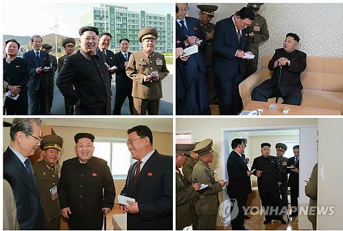 朝鲜《劳动新闻》14日在第一到第三版刊登了金正恩手持拐杖视察新建成的卫星科学家居住区的照片。(韩联社)