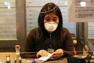 智利机场职员带口罩工作