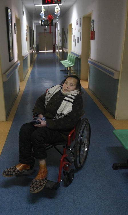 图文:徐祖清老人坐在轮椅上
