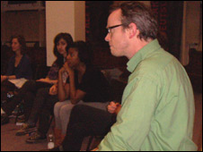 Director Tim Carol with some students