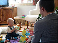 A father playing with a baby