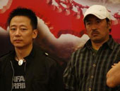 胡明(左)与刘永生
