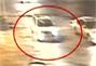 监控拍下轿车撞飞斑马线上女子后逃逸