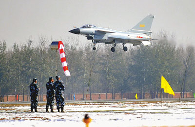 J-10 stand-alone low-speed level flight through the field.