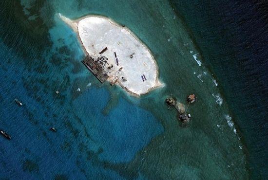 美卫星图证实越南在中国南海两岛礁填海(图)