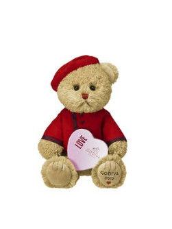 可爱的小熊伴着心形巧克力礼盒送来新颖独特的七夕节礼物,洋溢着活泼