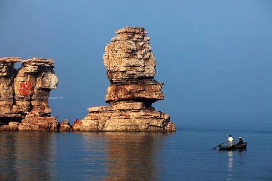 新浪旅游配图:长在海上的怪石 摄影:诗然
