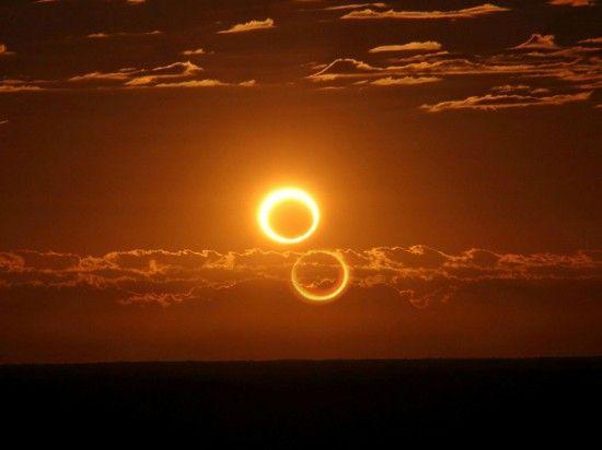 """澳大利亚的日全食照片,似悬挂于天空的""""火环""""。"""