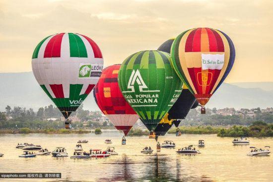 莱昂国际热气球节开幕,各色造型天空争艳。