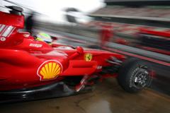 F1巴塞罗那试车次日仍遇雨迈凯轮再缺席马萨第一