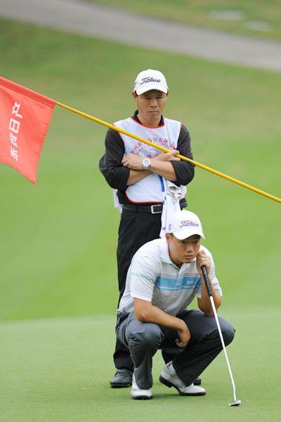 胡牧与父亲在比赛中(摄影:王凌)