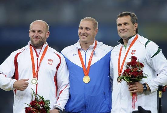 资料图片-北京奥运会男子铁饼前三名合影