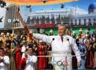 图文-北京奥运圣火在哈萨克斯坦传递 总统展示火炬