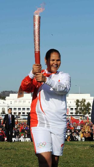 图文-北京奥运圣火在堪培拉传递 憨厚的表情