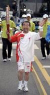 图文-北京奥运圣火在首尔传递 金德秀老骥伏枥