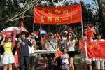 图文-北京奥运圣火在三亚传递 三亚艺人唱响奥运