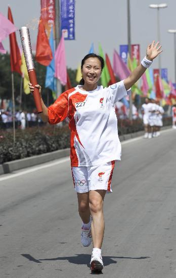 视频-圣火图文在甘肃兰州传递火炬手林媛v视频奥运赛乒澳图片