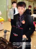 图文-中国乒乓球队从世乒赛凯旋郭跃心情不错